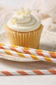 Closeup of vanilla cupcake with straws — Stock Photo