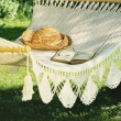 Crocheted hammock with straw hat and book — Stock Photo #72265255