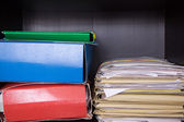 Documents on the shelf — Stock Photo