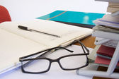 Documents and glasses on the table — Stock fotografie