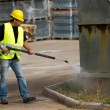 Worker in hard hat pressure washing — Stock Photo #59925399