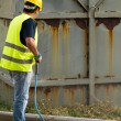 Worker in hard hat pressure washing — Stock Photo #59925431