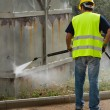 Worker in hard hat pressure washing — Stock Photo #59925457