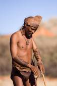 San man in native settlement — Stock Photo