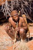 San man in native settlement — Stock Photo