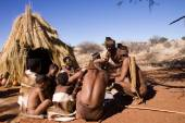 San people in native settlement — Stok fotoğraf