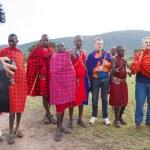 Kenyan maasai men with tourists — Stock Photo #61753629