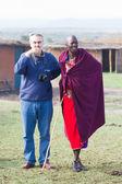 Kenyan masai man with tourist — Stock Photo