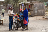 Masai tribal men with motorcycle — Stock Photo