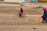 Masai tribal man on bike — Stock Photo