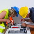 Electricians working indoors — Stock Photo #65025941
