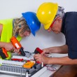 Electricians working indoors — Stock Photo #65026091