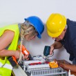 Electricians working indoors — Stock Photo #65026113
