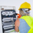 Female Electrician working — Stock Photo #65027769