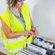 Female Electrician working — Stock Photo #65028819