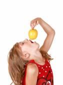 Girl eating an apple. — Stock Photo
