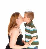 Mother kissing her little boy. — Stock Photo