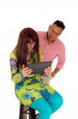 Husband and wife looking at there tablet. — Stock Photo