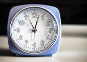 Old fashioned azure morning alarm clock — Stock Photo