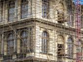 Fragment of scaffolding against house wall in Prague — Stock Photo