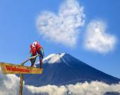 The sacred mountain of Fuji in the background of blue sky at Jap — Stock Photo