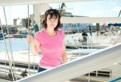 Woman on the yacht in marina in summer — Stock Photo