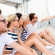 Smiling friends sitting on yacht deck — Stock Photo #51803527