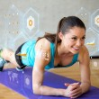 Smiling woman doing exercises on mat in gym — Stock Photo #51936983