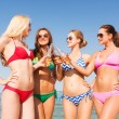 Group of smiling young women drinking on beach — Foto de Stock   #51937463
