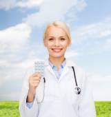 Smiling female doctor with pills — Stock Photo