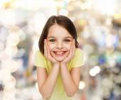 Smiling little girl over white background — Stock Photo