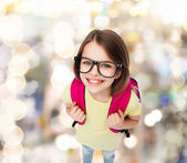 Happy smiling teenage girl in eyeglasses with bag — Stock Photo