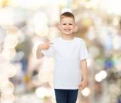 Smiling little boy in white blank t-shirt — Stock Photo