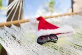 Hammock with santa helper hat and shades — Stock Photo