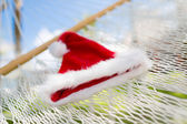 Picture of hammock with santa helper hat — Stock Photo