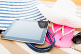 Close up of tablet pc on beach — Stock Photo