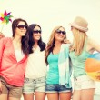Smiling girls in shades having fun on the beach — Stock Photo #52049069