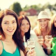 Smiling girls with champagne glasses — Stock Photo #52049153