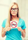 Woman with smoking restriction sign — Stock Photo