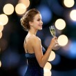 Smiling woman holding glass of sparkling wine — Stock Photo #52057255