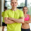 Smiling man and woman in gym — Stock Photo #52069445