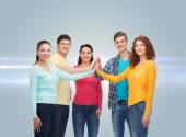 Smiling teenagers making high five — Stock Photo