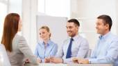 Smiling businesswoman at interview in office — Stock Photo