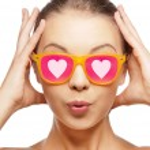 Surprised teenage girl in pink sunglasses — Stock Photo #52139497