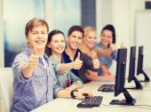 Students with computer monitor showing thumbs up — Stock Photo