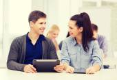 Students looking at tablet pc in lecture at school — Stock Photo