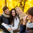 Group of friends with map outdoors — Stock Photo