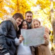 Group of friends with map outdoors — Stock Photo #52249439