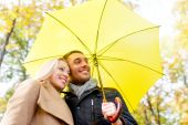 Smiling couple hugging in autumn park — Stock Photo