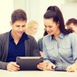 Students looking at tablet pc in lecture at school — Stock Photo #52300071